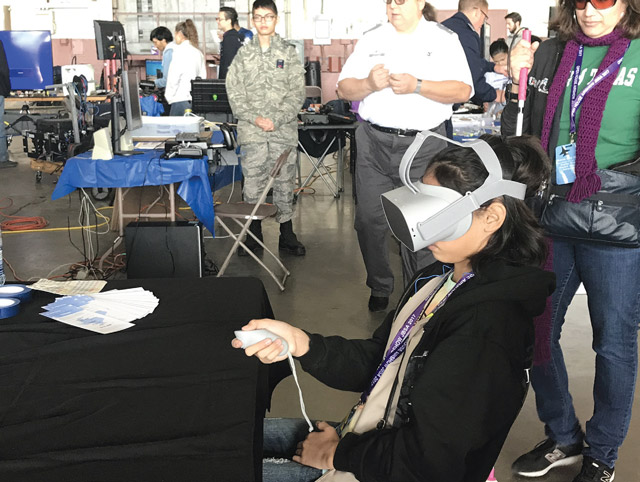 Kids gain exposure to tech devices such as VR headsets and 3D printers at the Port's Youth Aerospace Expo.