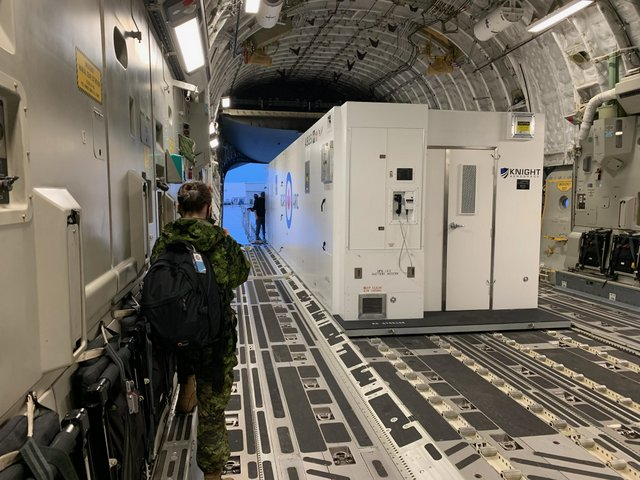 The ABCM operates within different types of cargo aircraft. Shown is one of the unit's first missions aboard a Royal Canadian Air Force C-17.