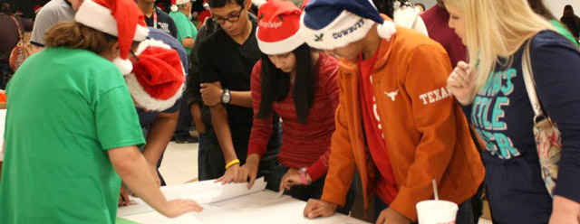 In 2012, the San Antonio Youth Commission volunteered with Elf Louise Christmas Project doing Santa deliveries. The Elf Louise Christmas Project is dedicated to providing a little bit of joy to Bexar County's less fortunate children through the donation of holiday gifts.